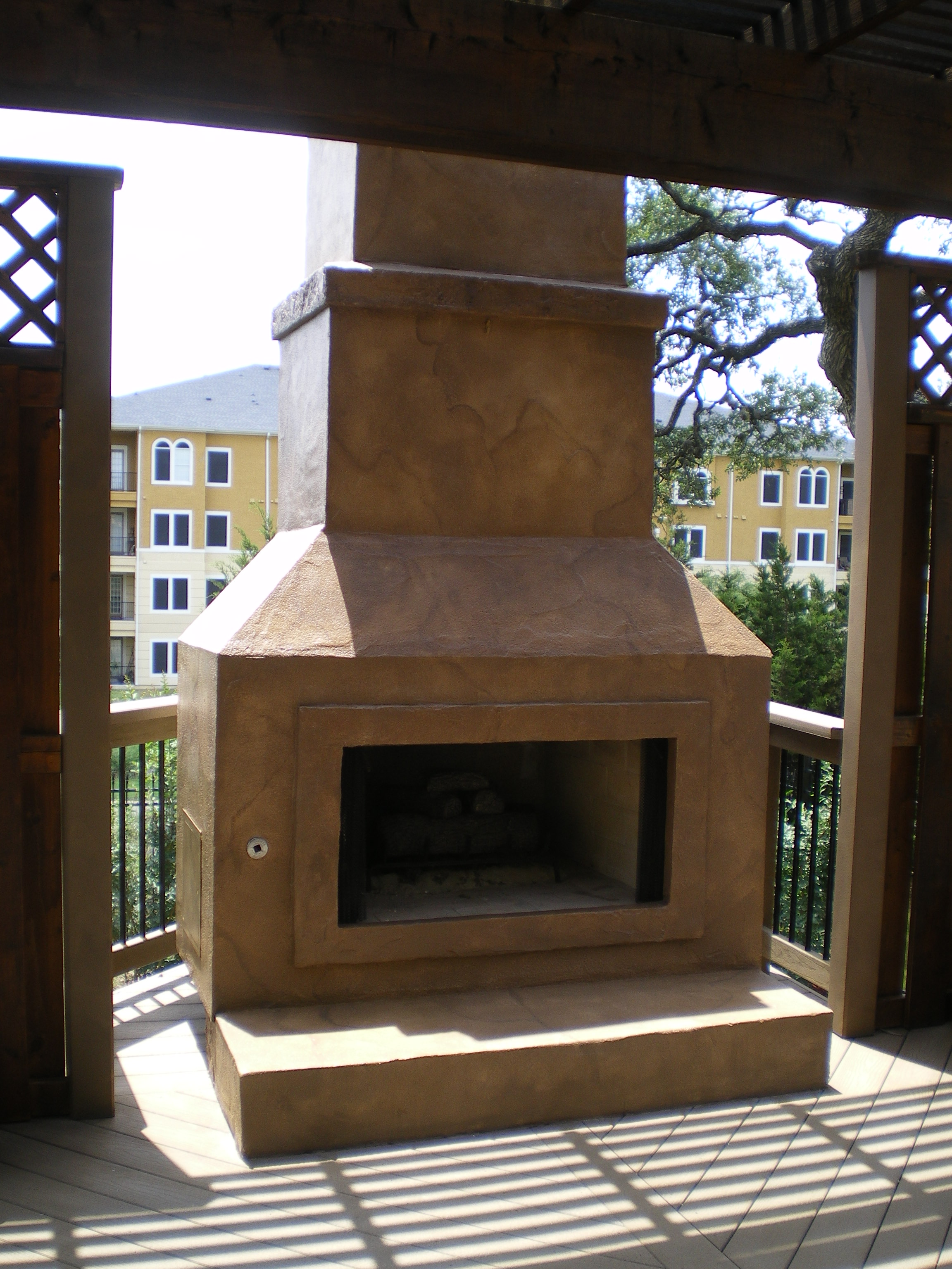 San Antonio, TX., Outdoor Patio Deck Fireplace in Faux Stone Look